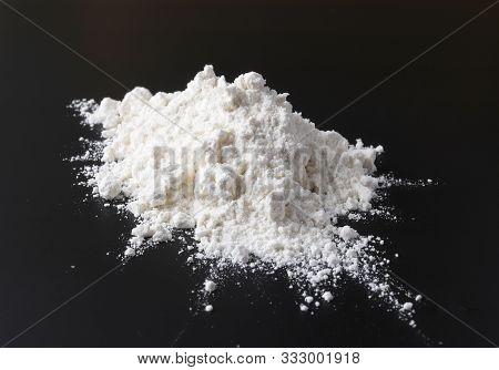 Heap Of Flour On Black Background Selective Focus