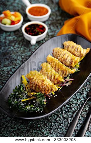 Deep Fried Potstickers Or Dumplings With Dipping Sauces
