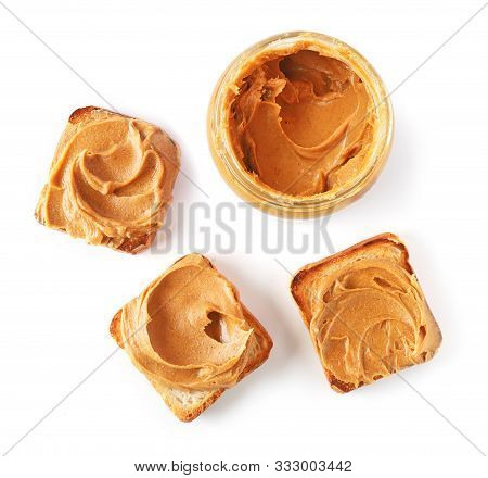 Jar And Toasted Bread With Peanut Butter Isolated On White Background, Top View