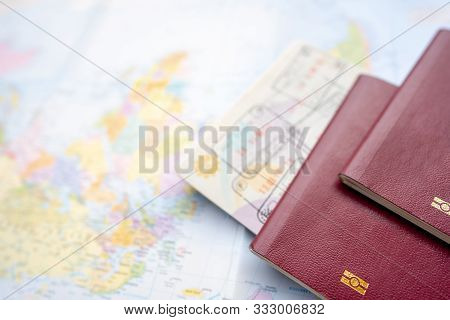 Passport On A Map Of The World. Globe Map On A Background.departure And Arrival Stamp With Visa On T