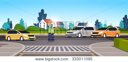 Police Inspector On Road With Cars Using Traffic Stick African American Policeman Officer In Uniform