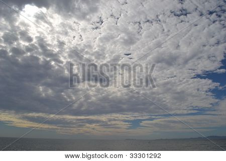 Cloudy day on calm sea