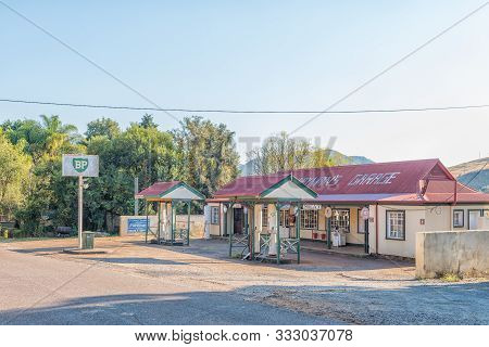 Pilgrims Rest, South Africa - May 21, 2019: A Street Scene, With An Historic Gas Station, In Pilgrim