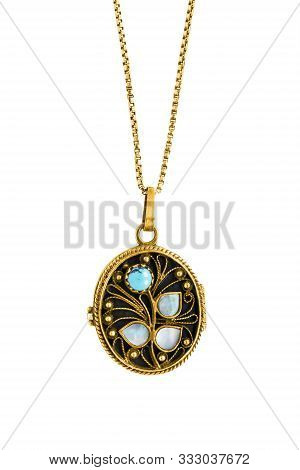 Vintage Gold Locket With Turquoise And Nacre Hanging On A Chain On White Background