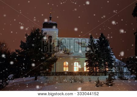 Christmas Time, Winter Landscape, Church In The Evening In Snowy Weather, Lit By Lights