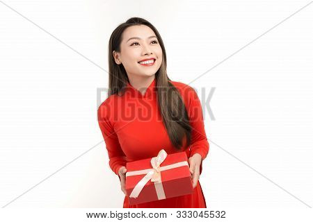 Beautiful Girl In Vietnamese Traditional Dress Is Smiling And Holding A Box With A Gift