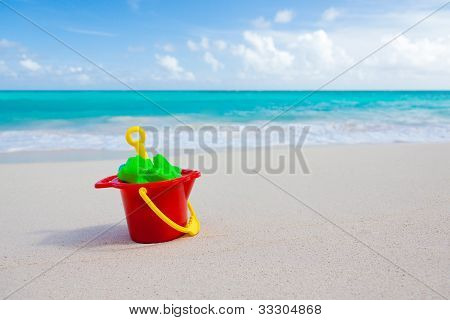 Bucket And Toys On Beach