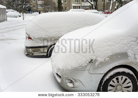 The Car, Covered With Thick Layer Of Snow. Negative Consequence Of Heavy Snowfalls. Parked Cars Cove