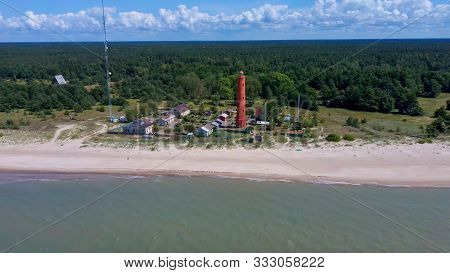 Aereal Dron Shot Akmenrags Lighthouse On The Latvian Coast Of The Baltic Sea, Located To The South O