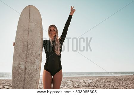 Young Woman Standing With Surfboard At Malibu Beach. California Lifestyle