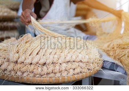 The Process Of Pulling Yellow Noodles After For Mee Sua Drying In The Sunlight Making Sun Dried Trad