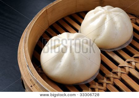 Steamed buns in steamer made with bamboo poster