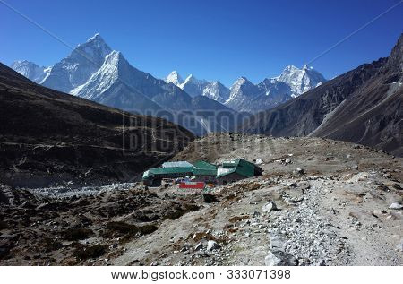 Everest trek, Guest houses of Dughla (4620 m) with view of Ama Dablam (6856 m) in Himalayas mountains, Sagarmatha national park, Solukhumbu, Nepal