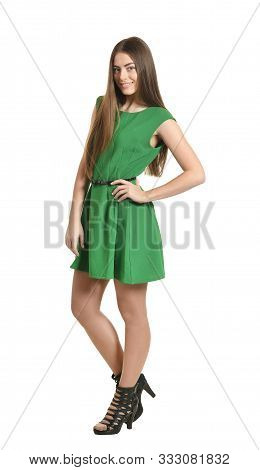 Beautiful Woman Posing In Green Dress On White Background