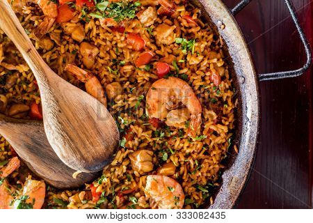 seafood paella on the wooden background