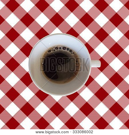 Top Veiw Cup Of Coffee On A Vichy Table Cloth