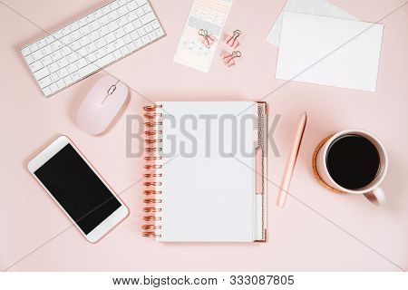 Minimal Women Office Desktop With Keyboard, Laptop Mouse, Phone, Pen, Coffee Mug And Notebook On Pin