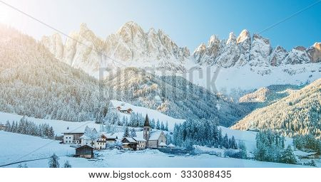 Beautiful Panoramic View Of Famous Dolomites Mountain Peaks With The Village Val Di Funes And Histor