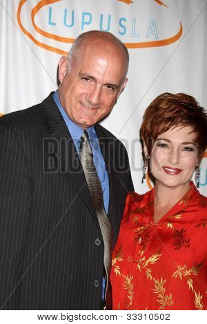 LOS ANGELES - MAY 24:  Donald Agnelli, Carolyn Hennesy arrives at the 12th Annual Lupus LA Orange Ball at Beverly Wilshire Hotel on May 24, 2012 in Beverly Hllls, CA