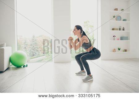 Full Size Profile Side Photo Of Joyful Agility Lover Girl Doing Sport Yoga Exercises Sit Squats Prac