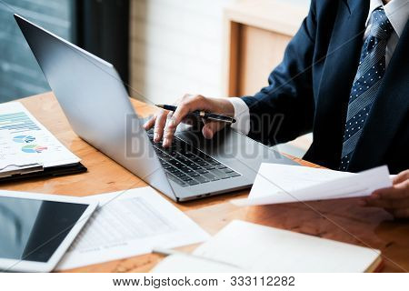 Close-up Of Male Hands Using Laptop, Man's Hands Typing On Laptop Keyboard, Side View Of Businessman
