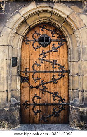 Antique Wooden Door. Wooden Door Arch. Stone Arch And Closed Door