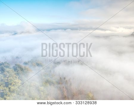 Heavy Misty Daybreak. Misty Daybreak In A Beautiful Hills. Peaks Of Hills Are Sticking Out From Fogg
