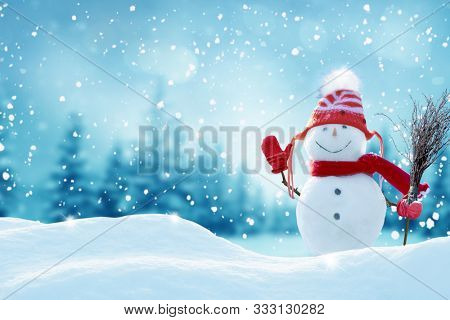 Happy  snowman standing in christmas landscape.Snow background.Winter fairytale.Merry christmas and happy new year greeting card with copy-space.
