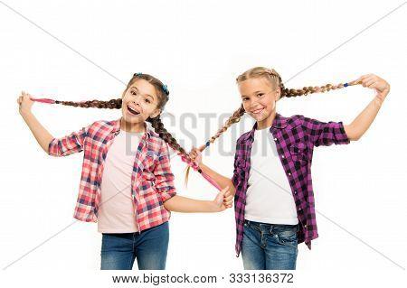 Such A Long Hair. Happy Little Girls Wear Plaited Hair. Cute Small Childred Hold Hair Braids. Luxuri