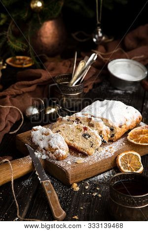 Homemade Traditional Christmas Dessert Stollen With Dried Berries, Nuts And Powdered Sugar On Top St