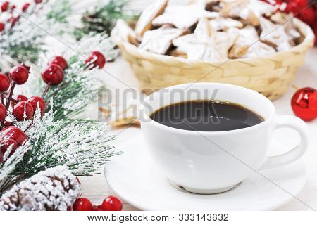 A White Mug Of Black Americano Coffee On A White Wooden Background Next To The Christmas Branch And
