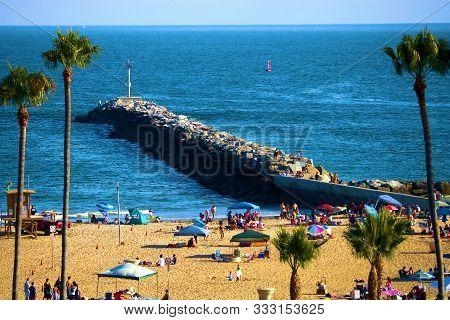 August 25, 2019 In Corona Del Mar, Ca:  Beachgoers Enjoying Activities On The Sandy Beach Including