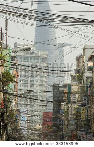 Ho Chi Minh City (saigon), Vietnam - February 13, 2011: Bitexco Financial Tower On Background Of Sai