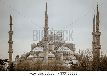 Istanbul, Turkey, 21 March 2019: Suleymaniye Mosque in summer, Turkey. Suleymaniye Mosque is a famous landmark of Istanbul. Sunny view of courtyard of the Suleymaniye Camii. Magnificent Ottoman