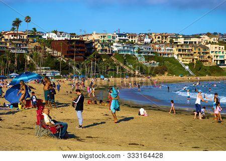 August 25, 2020 In Corona Del Mar, Ca:  Beachgoers Enjoying Festive Activities On The Vast Sandy Bea