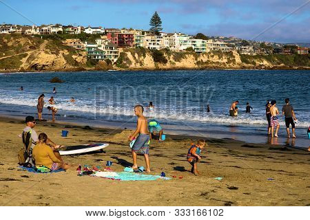 August 25, 2020 In Corona Del Mar, Ca:  Crowds Of People Sunbathing And Swimming At The Corona Del M