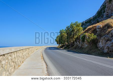 Turn The Highway With A Stone Parapet Under The Rock On Which Stands The Fortress Of Fortezza. Greec
