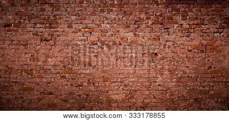 Panoramic Old Messy Red Brick Wall Background. Vintage Brick Texture. Wide Angle Web Banner Or Wallp