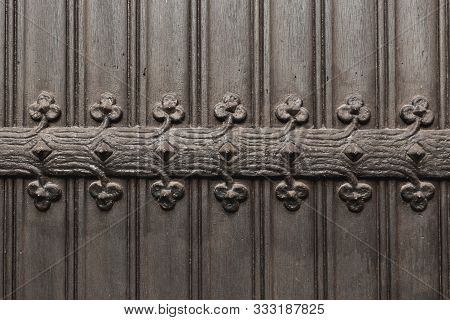 Vintage Metallic Pattern Of Wrought Iron Door. Detail Of Medieval Black Door With Metal Decoration,