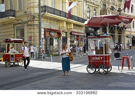 Istanbul, Turkey - September 9th 2019. Street Vendor Carts Sell Roast Chestnuts And Baguels To Passe