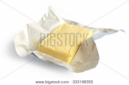 Piece Of Butter Isolated On White Background