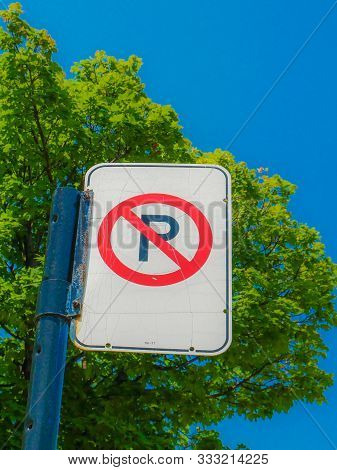 No Parking Sign In A Street Of Montreal, Canada