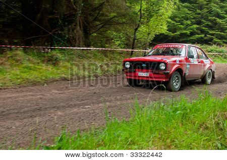 A. Commins Driving Ford Escort