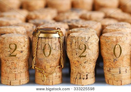 Closeup of a large group of Champagne corks, With the year 2020. Ideal for New Years Themed projects