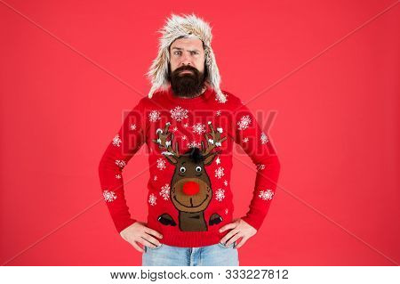 Buy Festive Clothing. Sweater With Deer. Hipster Bearded Man Wear Winter Sweater And Hat. Happy New