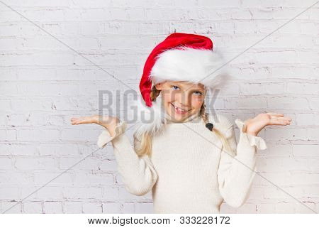 cute little christmas girl in Santa hat  smiling and happy
