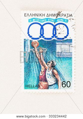 Seattle Washington - October 5, 2019: Basketball Players On Greek Stamp Commemorating The 11th Medit