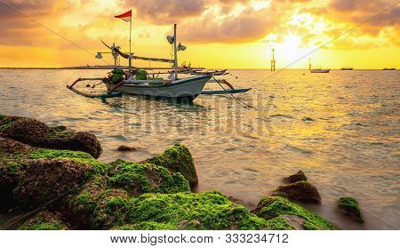 Morning Sun In Bali, Indonesia. Traditional Fishing Boats At Sanur Beach, Bali, Indonesia.