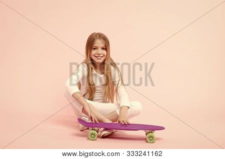 Active Lifestyle. Girl Having Fun With Penny Board Pink Background. Kid Adorable Child Long Hair Ado