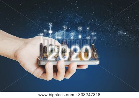 Smart Technology On Mobile Device, Hand Holding Mobile Smartphone And 2020 Augmented Reality, New Te